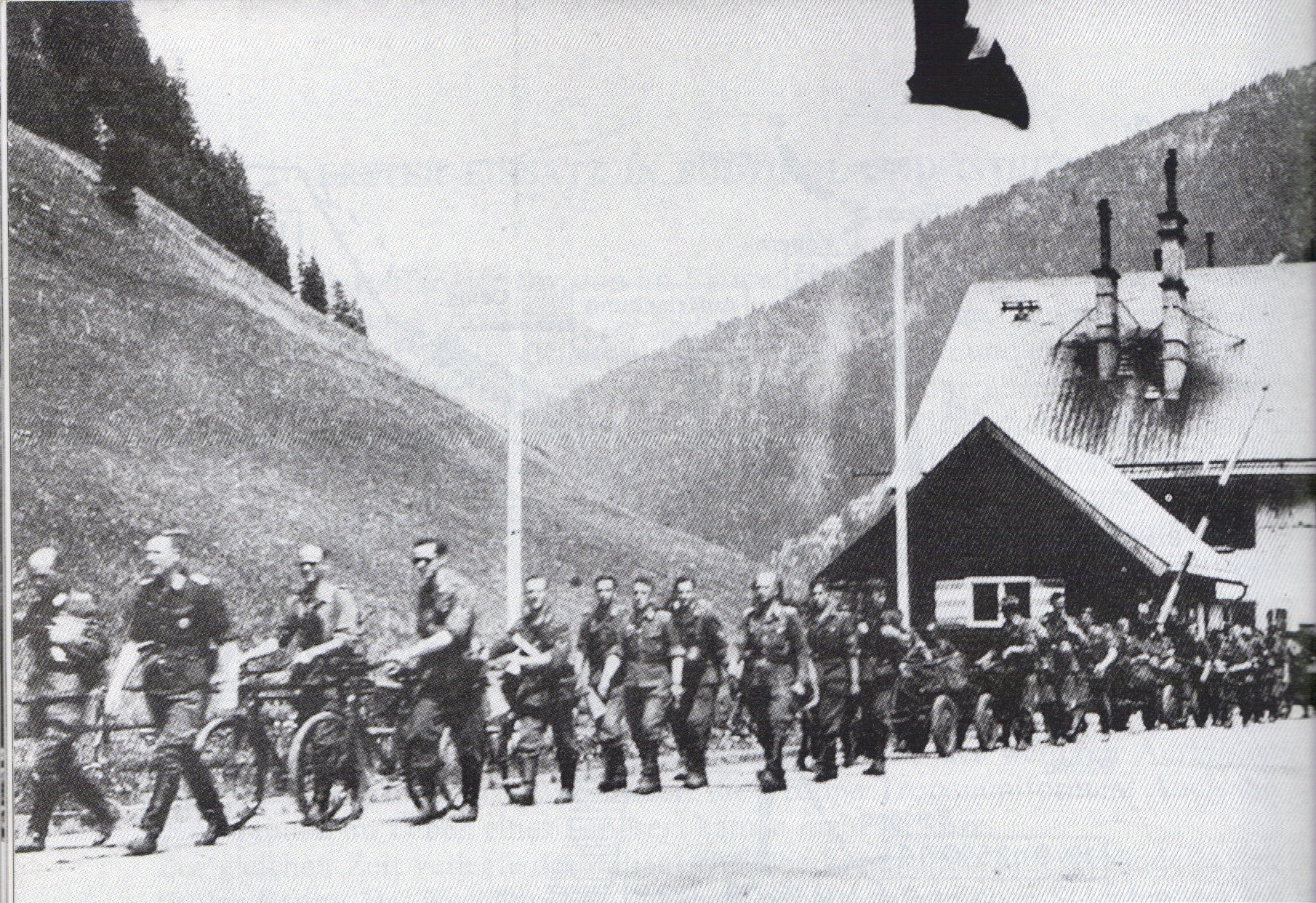 Officers & men of 5. and 6. Kp RGrenRgt HuD crossing the border at the Brenner Pass into Italy, 1 August 1943.